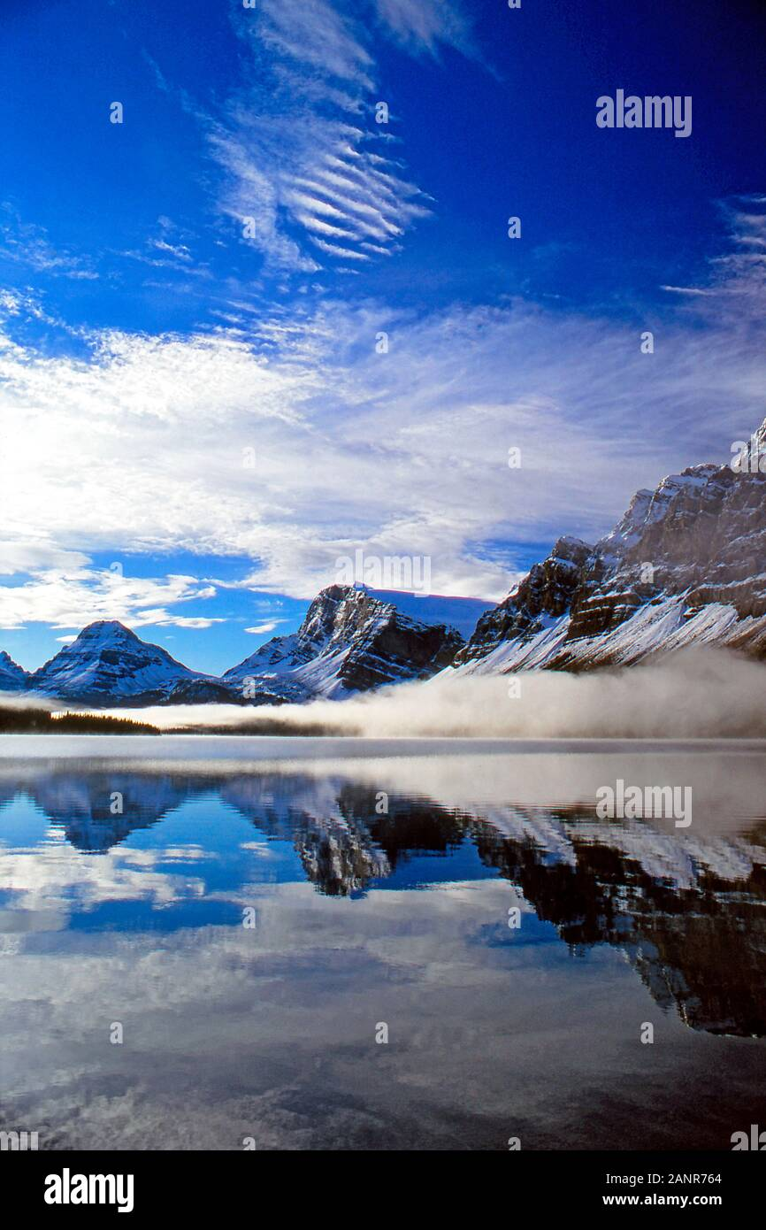 Early morning mist on Bow Lake, Banff National Park, Alberta Canada Stock Photo