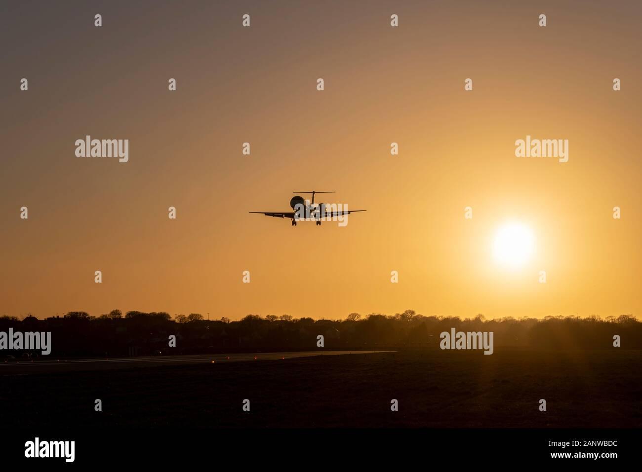 loganair-embraer-erj-145-jet-plane-g-sajg-landing-at-london-southend-airport-essex-uk-late-afternoon-in-winter-sunset-dusk-warm-orange-glow-2ANWBDC.jpg