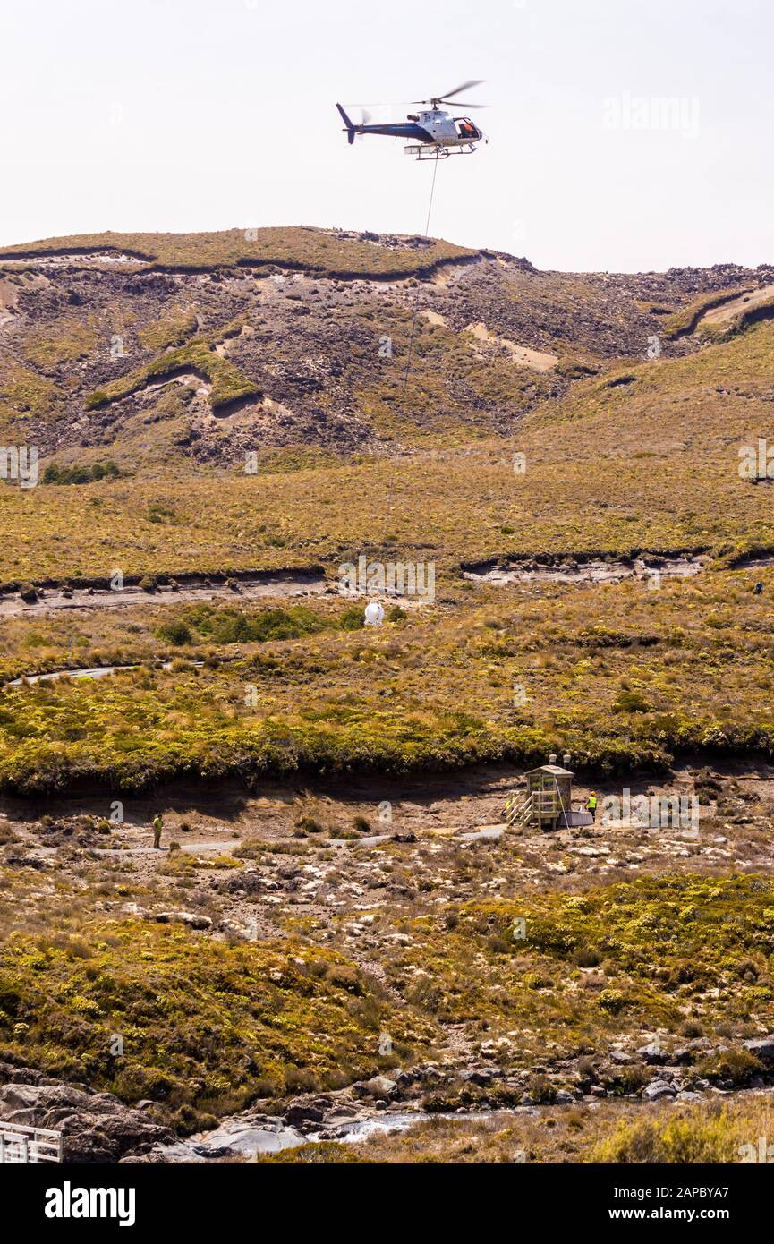 helicopter-on-public-toilet-cleaning-duty-near-mount-ruapehu-tongariro-national-park-north-island-new-zealand-2APBYA7.jpg