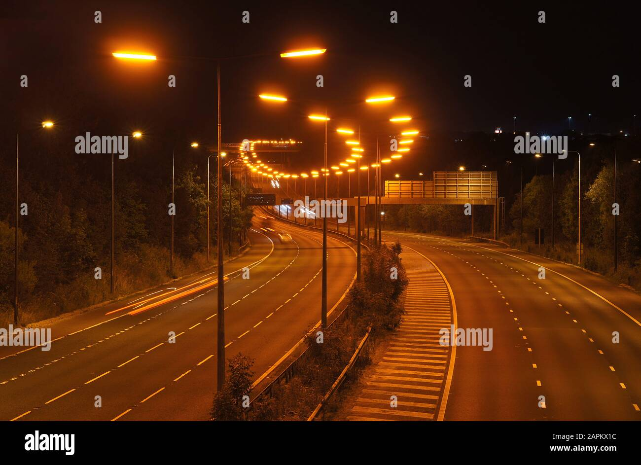 Low Pressure Sodium street lights on an English motorway. Stock Photo