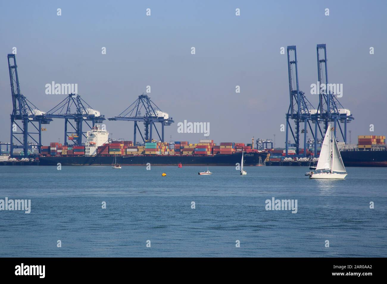 cranes at the port of Felixstowe viewed from Harwich on the essex coast Stock Photo