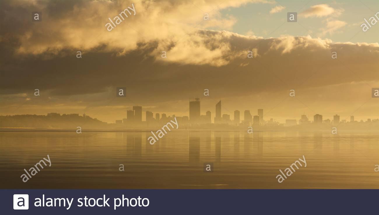 perth-city-in-mist-shortly-after-sunrise-as-seen-from-the-applecross-foreshore-on-the-swan-river-western-australia-2ARE6AX.jpg