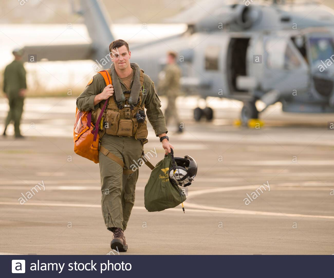 Sikorsky SH-60R Seahawk pilot walking towards hanger after fly in to Marine Corps Base Hawaii, Kaneohe, Honolulu, Oahu, Hawaii, USA Stock Photo