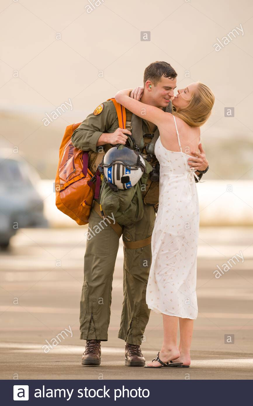 United States Navy Sikorsky SH-60R Seahawk pilot hugging his fiancé who greeted him at a fly in to Marine Corps Base Hawaii, Kaneohe Stock Photo