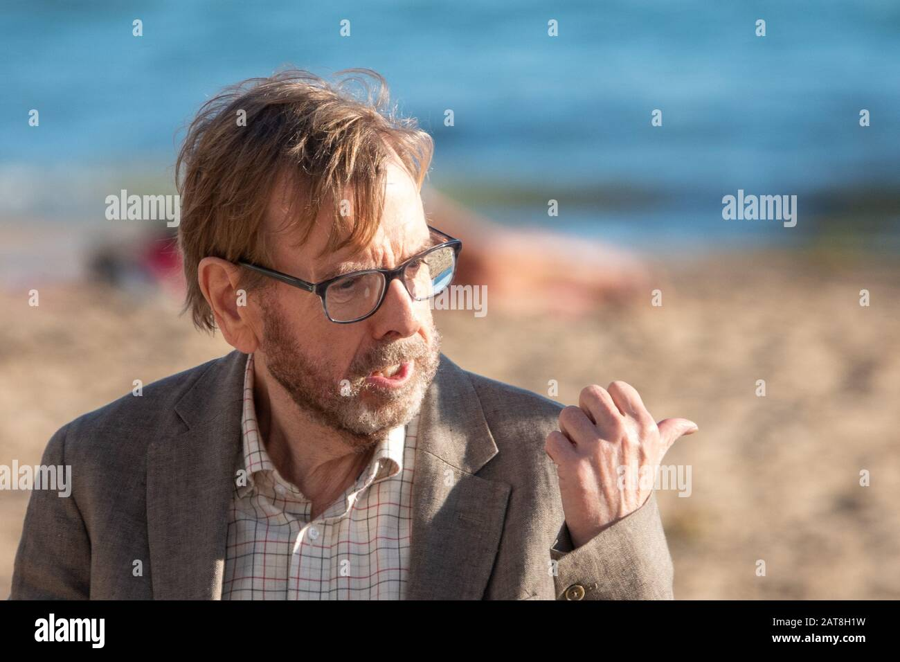 "Benidorm, Costa Blanca, Spain. 31st Jan, 2020. British actor Timothy Spall on location for the movie ""It snows in Benidorm"" Seen here on Levante Beach. Credit: Mick Flynn/Alamy Live News Stock Photo"