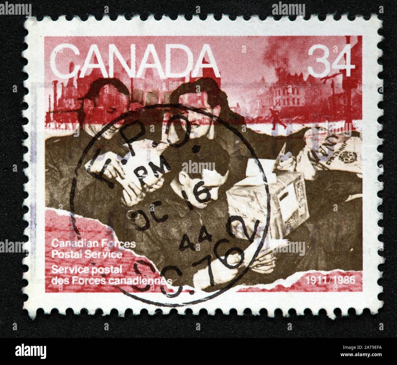 Hotpixuk,@Hotpixuk,GoTonySmith,stamp,postal,franked,frank,used stamps,used franked,used,franked stamp,from envelope,history,historic,old,poste,post office,communications,postage,sending letters,sending,parcels,34c,Service Postal des forces canadiennas,34c stamp,Canadian Forces,Postal service,Service Postal,des,forces canadiennas,army,navy,fighting,forces,airforce,air force,Canadian