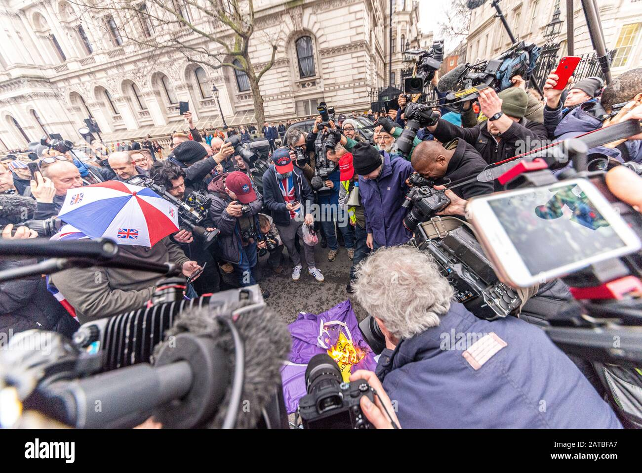 media-cameras-and-photographers-surrounding-an-attempt-to-burn-a-european-union-flag-on-brexit-day-31-january-2020-in-london-uk-press-crews-2ATBFA7.jpg