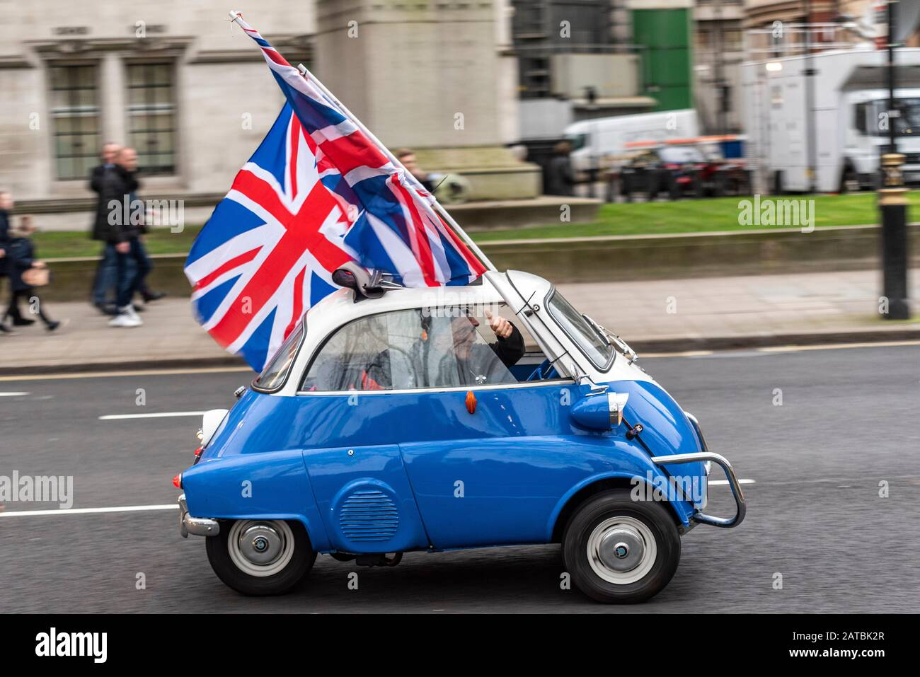 bmw-isetta-microcar-driving-around-parliament-square-on-brexit-day-31-january-2020-in-london-uk-with-union-jack-flags-european-bubble-car-2ATBK2R.jpg