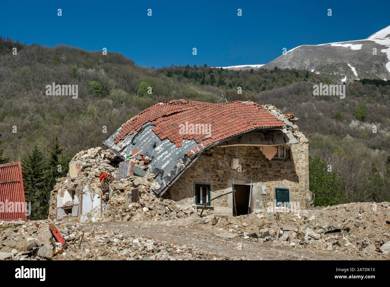 Ruined house in village of Piedilama, destroyed by earthquakes in October 2016, Monti Sibillini National Park, Central Apennines, Marche, Italy Stock Photo