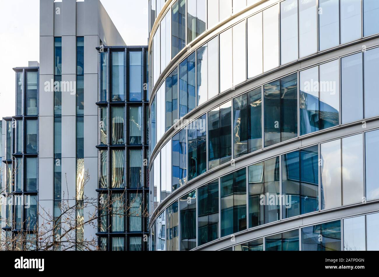 close-up-view-of-detail-on-a-modern-glass-building-with-reflective-glass-and-contemporary-design-2ATPDGN.jpg