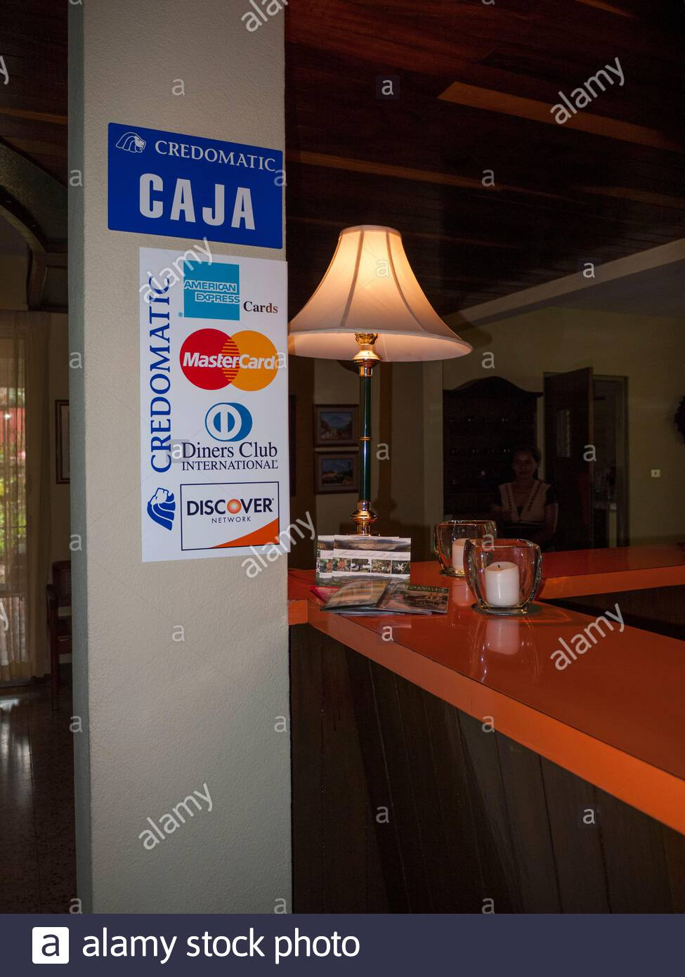 Credomatic sign in a hotel in Nicargua.  Credomatic is owned by the Pellas family, which also sells beer and rum and automobiles in Nicaragua. Stock Photo