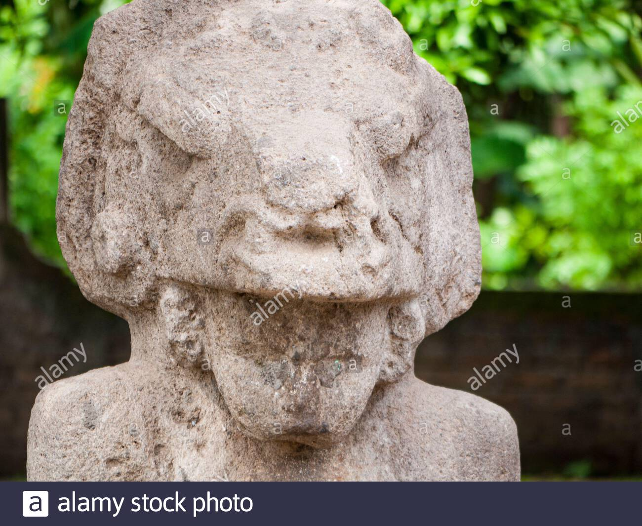 Detail of  a stone sculpture of a man wearing a jaguar helmet, from Ometepe Island. Stock Photo