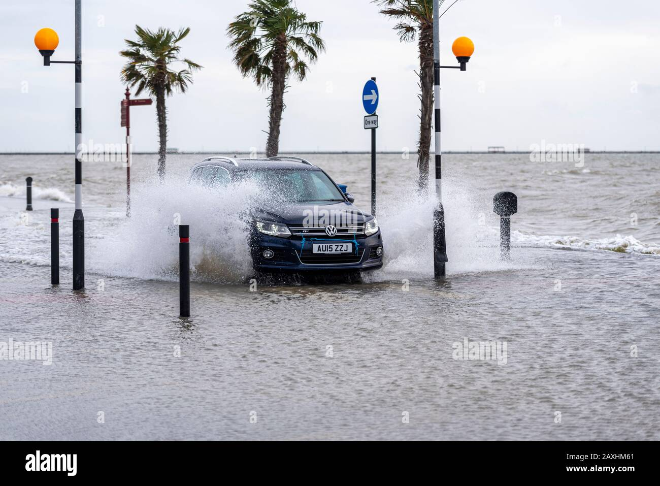car-driving-through-floodwater-during-the-high-tide-storm-surge-following-storm-ciara-in-southend-on-sea-essex-uk-submerged-zebra-crossing-2AXHM61.jpg