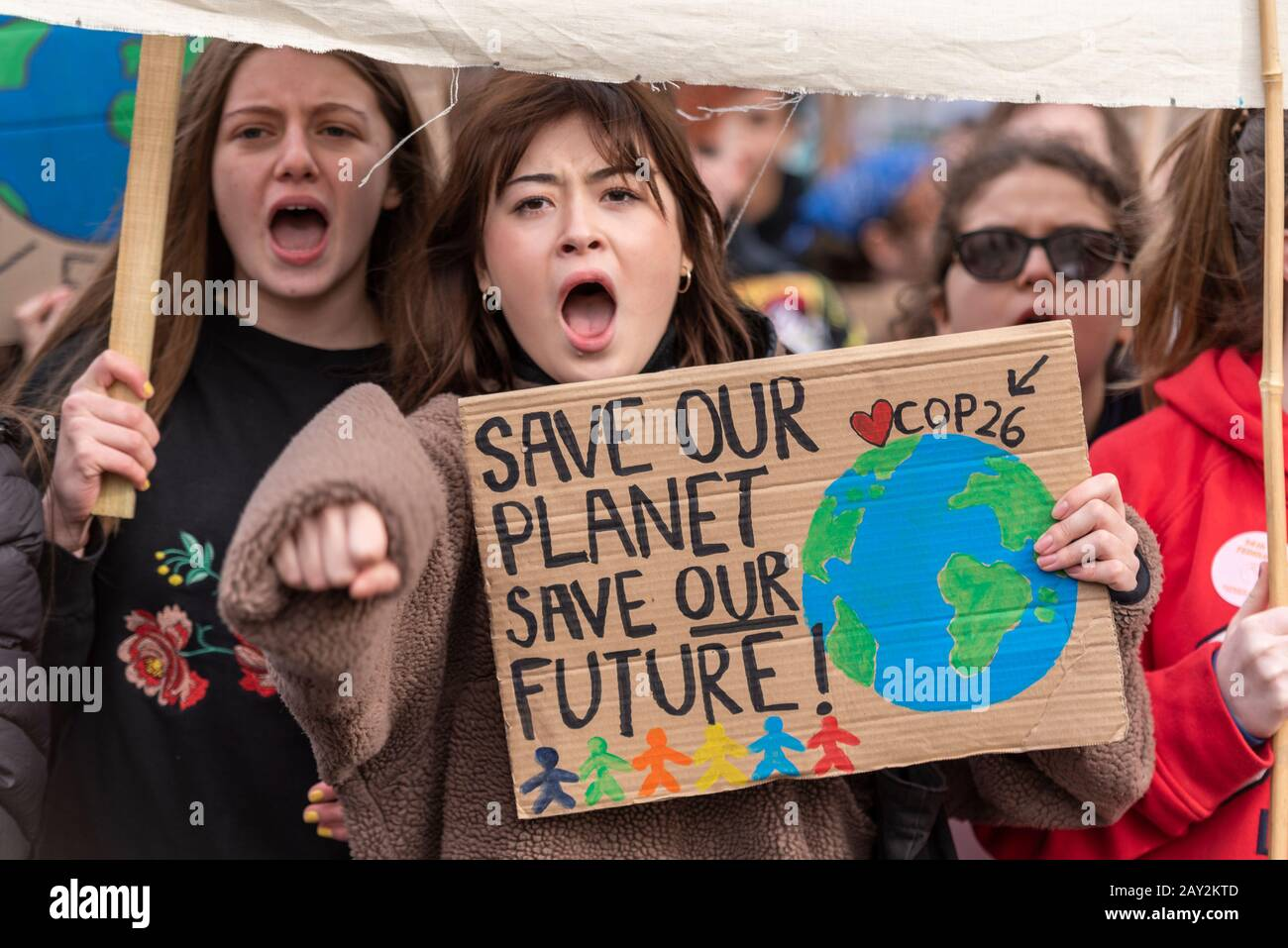 parliament-square-london-uk-14th-feb-2020-one-year-after-the-first-uk-youth-climate-strike-youngsters-are-again-protesting-to-demand-climate-action-they-believe-that-governments-are-not-acting-fast-enough-to-reverse-the-damage-to-the-climate-many-skipped-their-education-to-attend-2AY2KTD.jpg