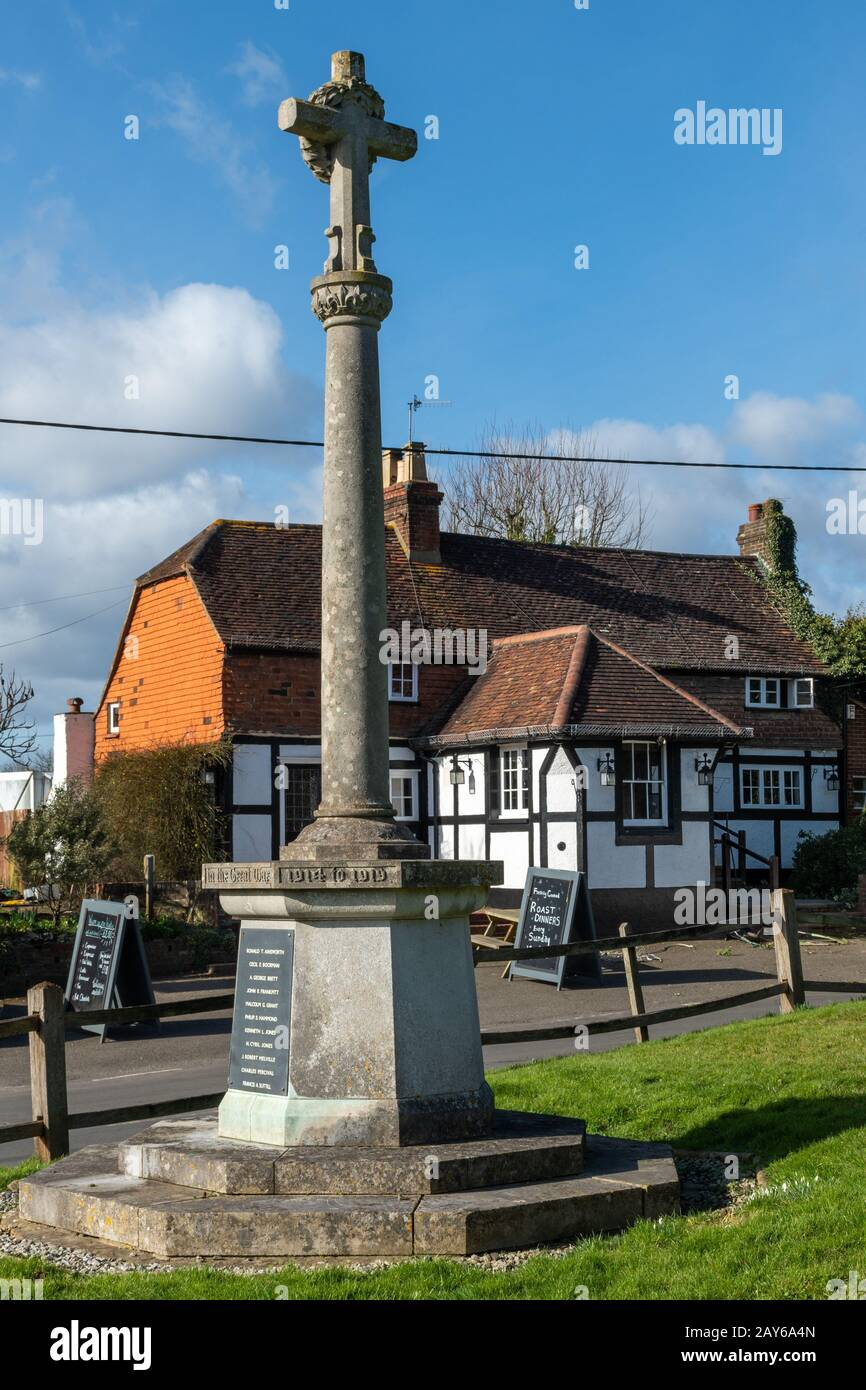 village-of-newdigate-surrey-uk-with-the-war-memorial-and-pub-called-the-six-bells-2AY6A4N.jpg