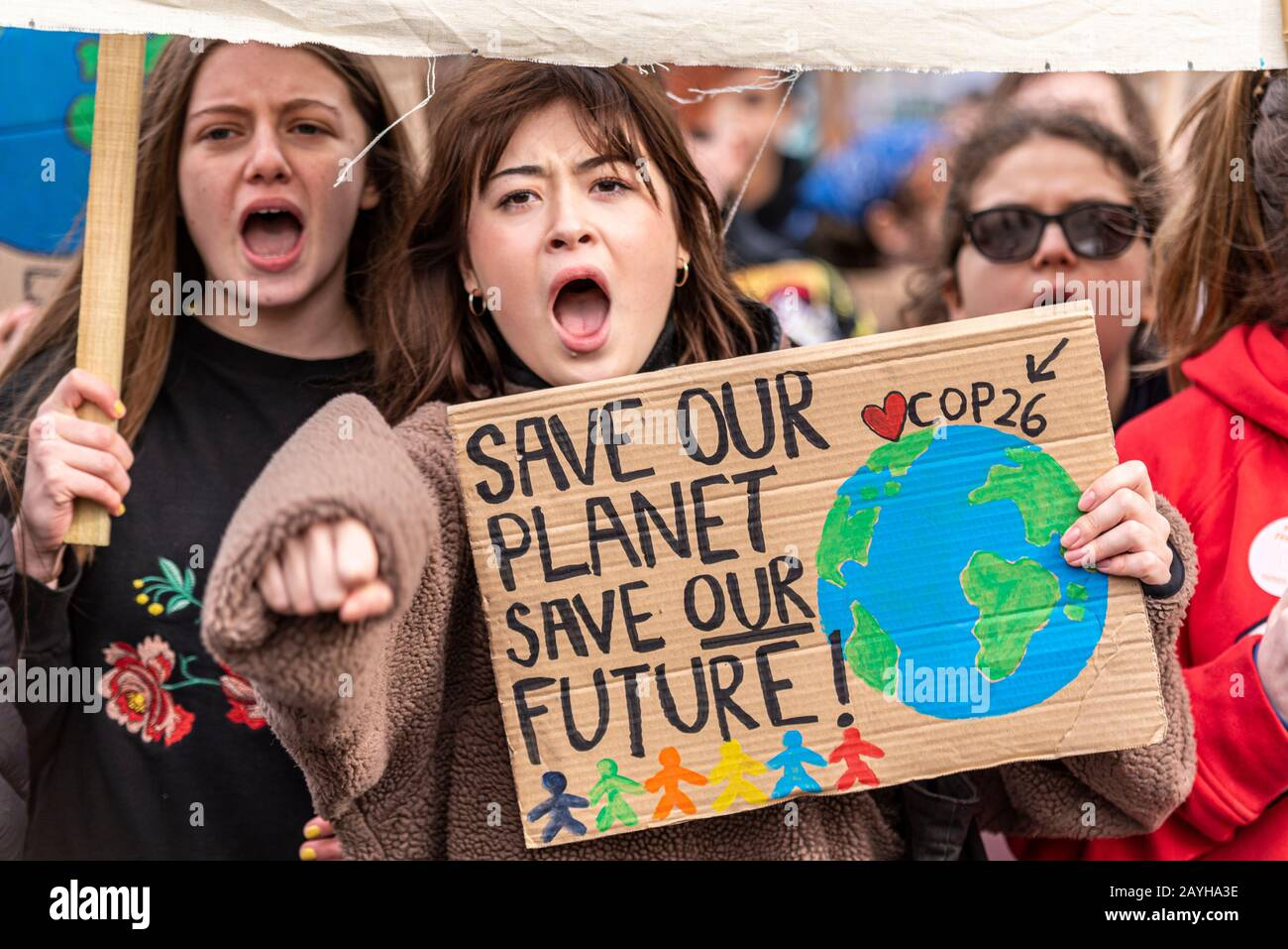 youngsters-at-a-youth-strike-4-climate-protest-in-parliament-square-london-uk-children-out-of-school-demonstrating-for-action-on-global-warming-2AYHA3E.jpg