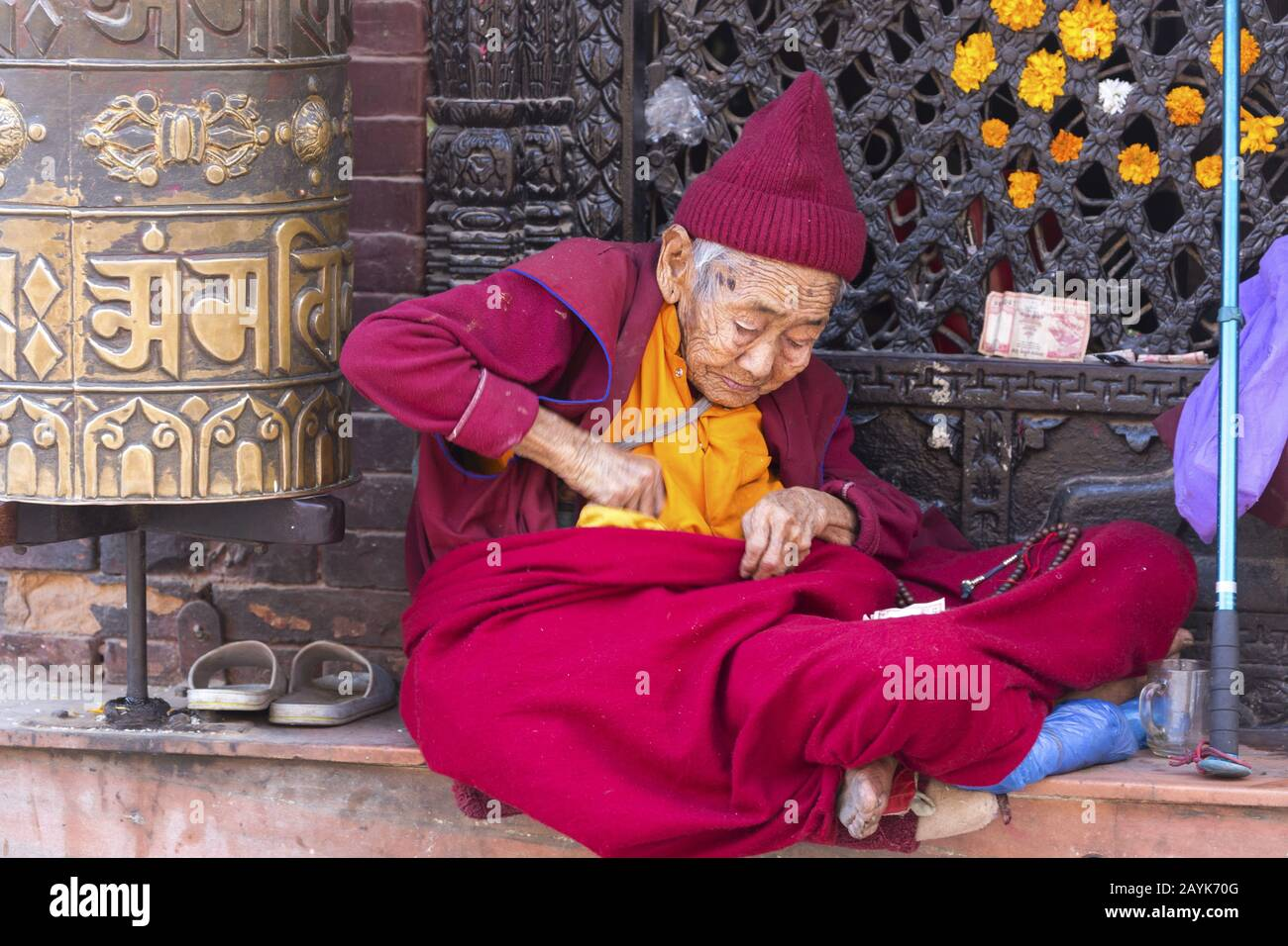 poor-old-nepalese-woman-with-red-clothin