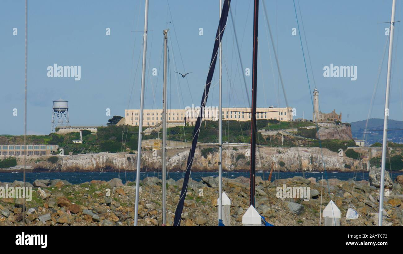 Alcatraz Island and Prison behind sailboats, view from Yacht Harbor in Marina District. USA National Historic Landmark in the San Francisco Bay. Stock Photo