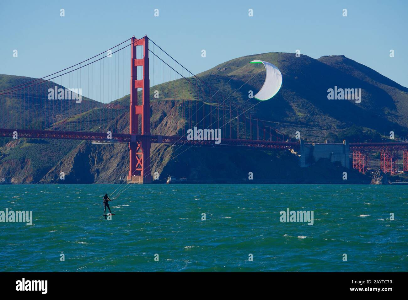 kite-surfer-or-kiteboarder-with-white-sail-on-a-windy-day-in-front-of-the-golden-gate-bridge-and-the-marin-headlands-san-francisco-bay-2AYTC7R.jpg