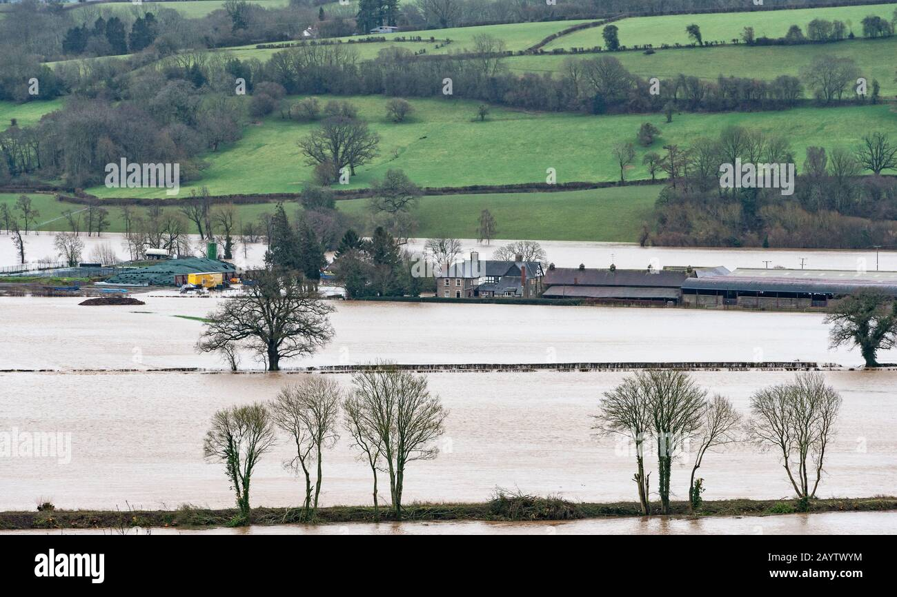 A view of Sheepcote Farm at Clifford, Herefordshire, near Hay-on-Wye, flooded by the River Wye as a result of Storm Dennis (16th February 2020) Stock Photo