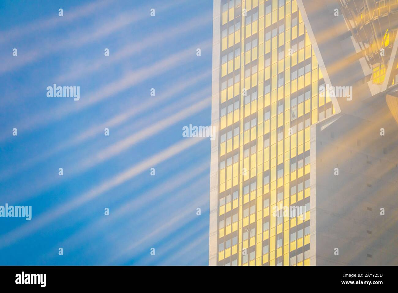 intempo-high-rise-residential-property-sun-rays-reflecting-off-golden-glazed-tower-block-through-mist-noise-in-image-due-to-mist-2AYY25D.jpg
