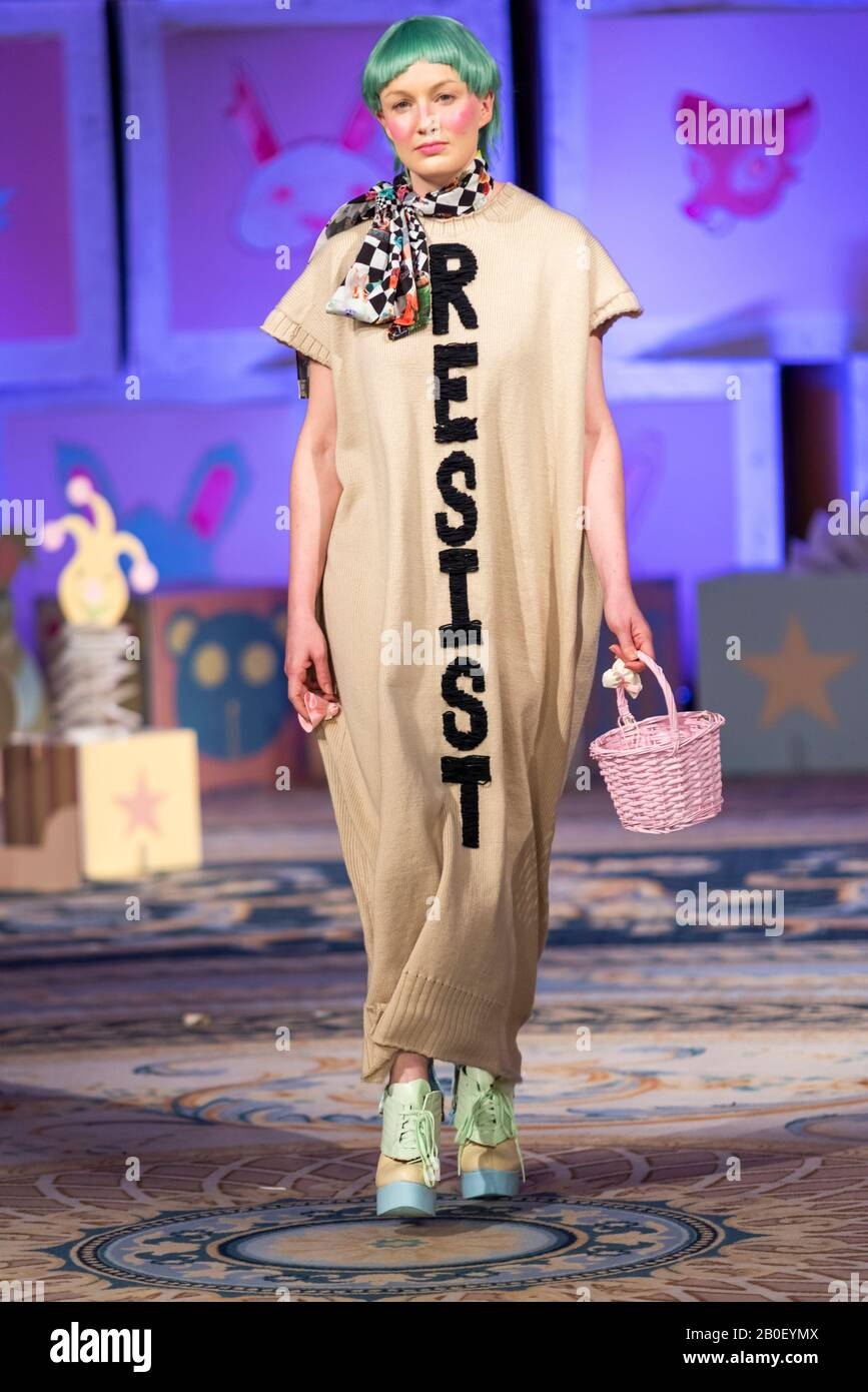 vin-and-omi-london-fashion-week-resist-aw20-show-eco-friendly-clothing-designed-from-recycled-fabric-female-modelling-long-knitwear-with-resist-2B0EYMX.jpg