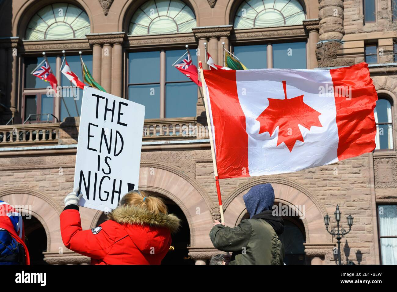 Anti-pipeline protesters denounce Canada at the Ontario Legislative Building during the Shut Down Canada protests in solidarity with the Wet'suwet'en. Stock Photo