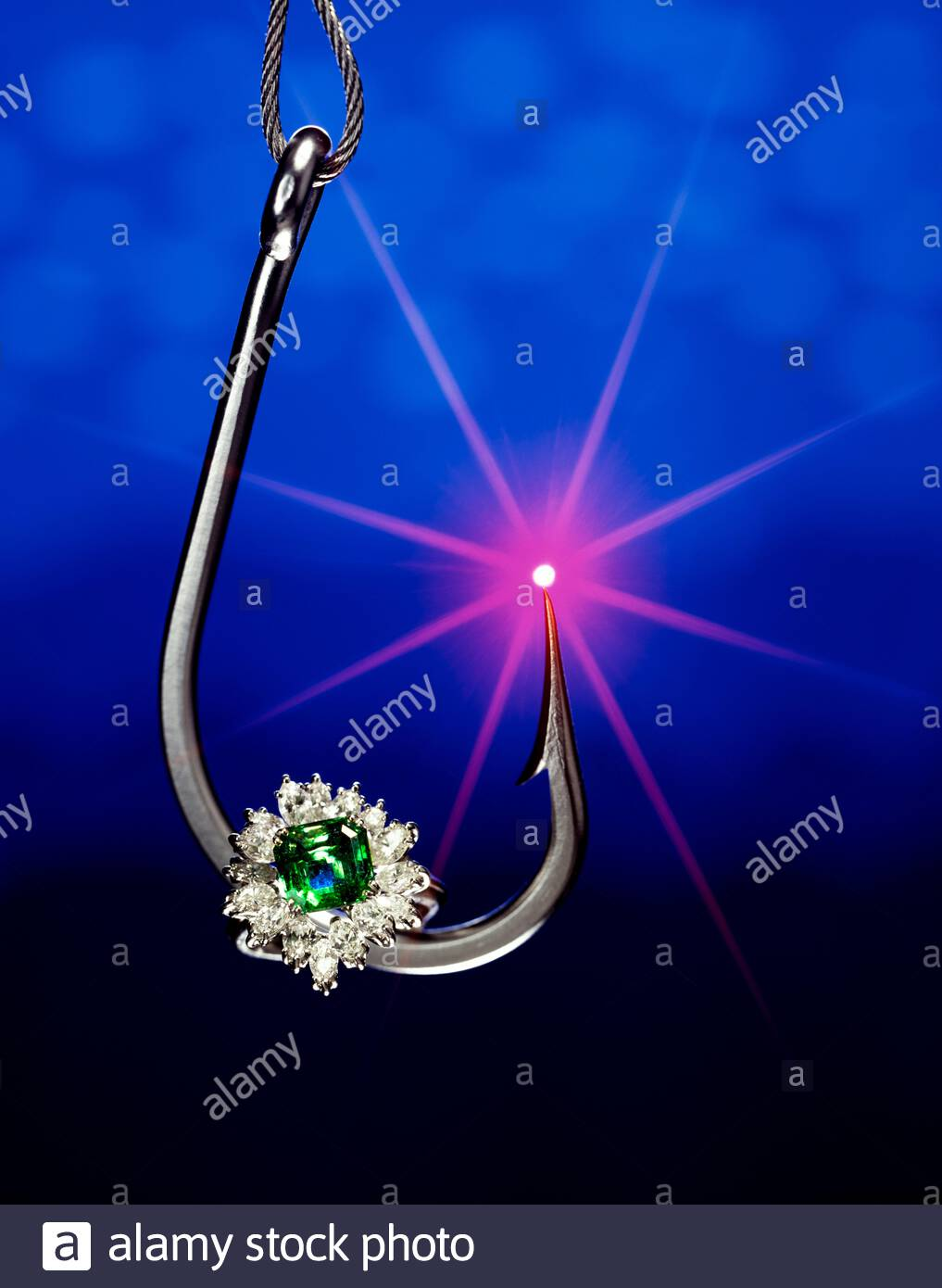 Expensive jewelry used as bait on large hook Stock Photo