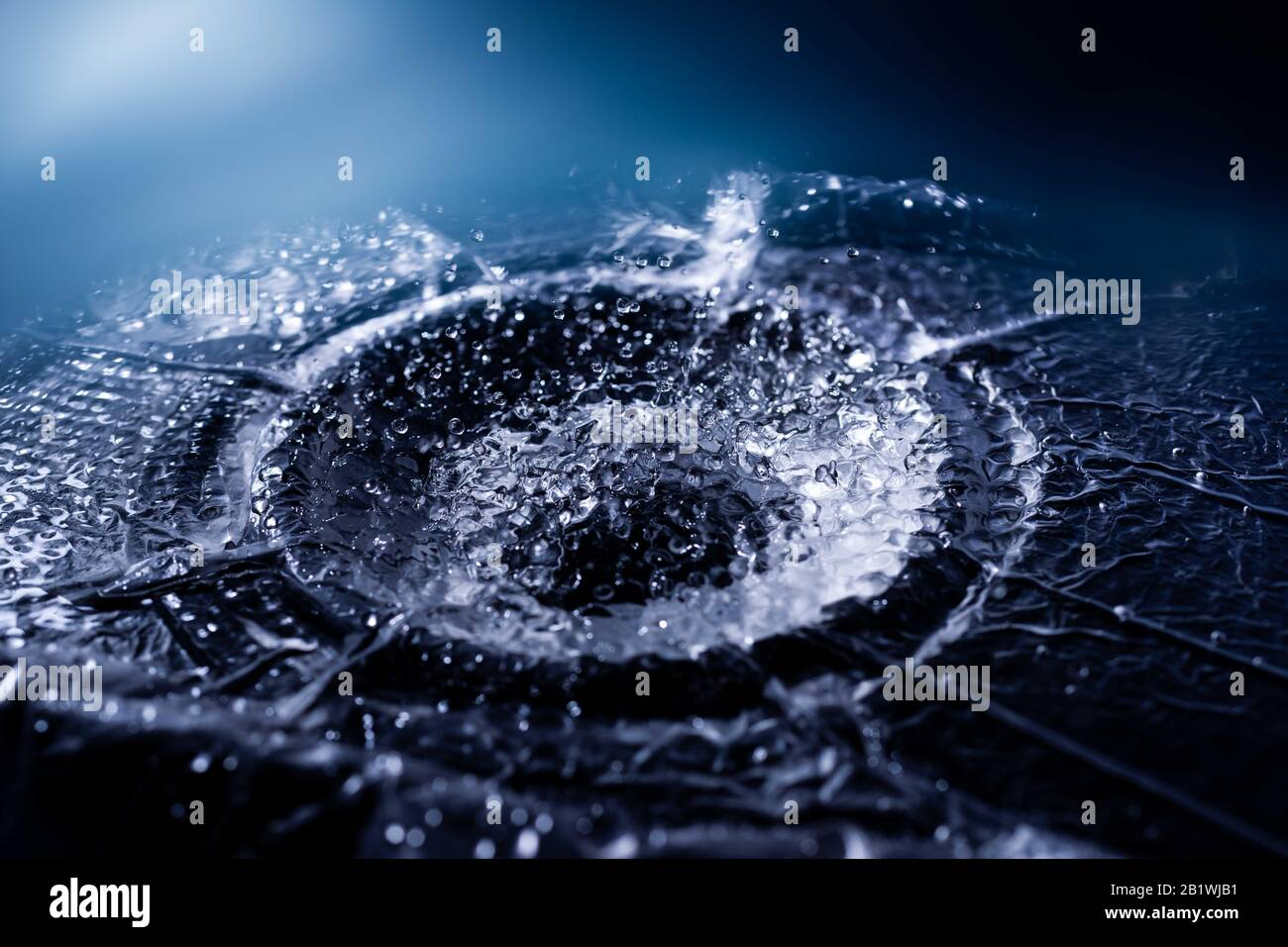 Water drops splashing on acoustic membrane. A lot of drops in air. High frequency of sound waves. Water cloud small drops. Frozen time shot. Stock Photo