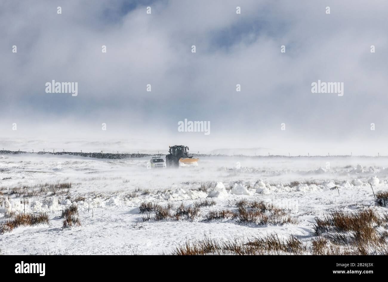 Teesdale, County Durham, UK. 1st March 2020. UK Weather.  The Teesdale and Weardale Search and Mountain Rescue Team, Police and snow plough driver Dan McLaughlin battled through deep snow and blizzard conditions at the height of Storm Jorge to rescue 8 off roaders, which included a child, who were trapped in 4 vehicles overnight on a remote moorland track near Coldberry End in Upper Teesdale.   Credit: David Forster/Alamy Live News Stock Photo