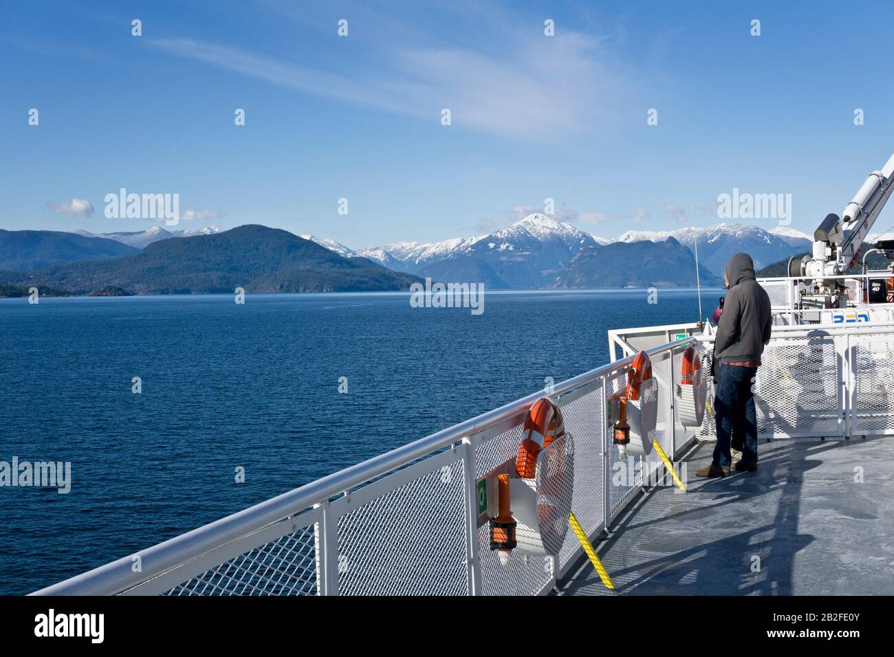 View from a BC Ferry traveling to the Sunshine Coast of British Columbia in the Winter.  Beautiful water and mountain views on a BC ferry deck. Stock Photo