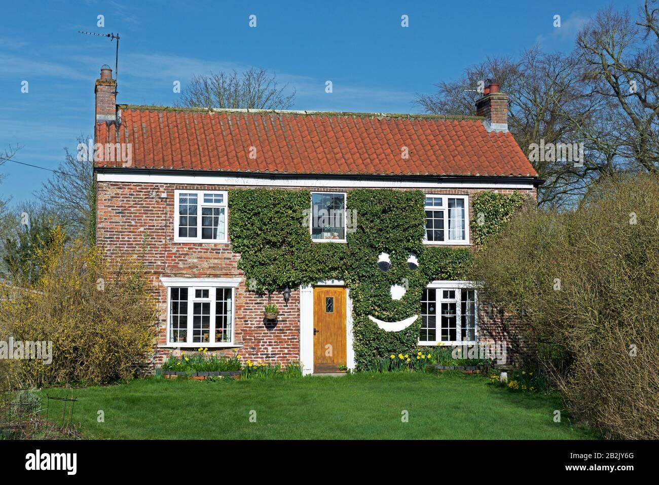 happy-house-in-the-village-of-hayton-east-yorkshire-england-uk-2B2JY6G.jpg