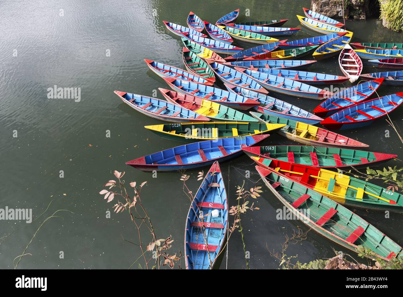 group-of-multi-colored-fishing-boats-on-
