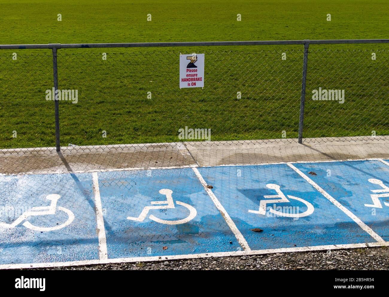 apply-handbrake-sign-in-disabled-parking-area-2B5HR54.jpg