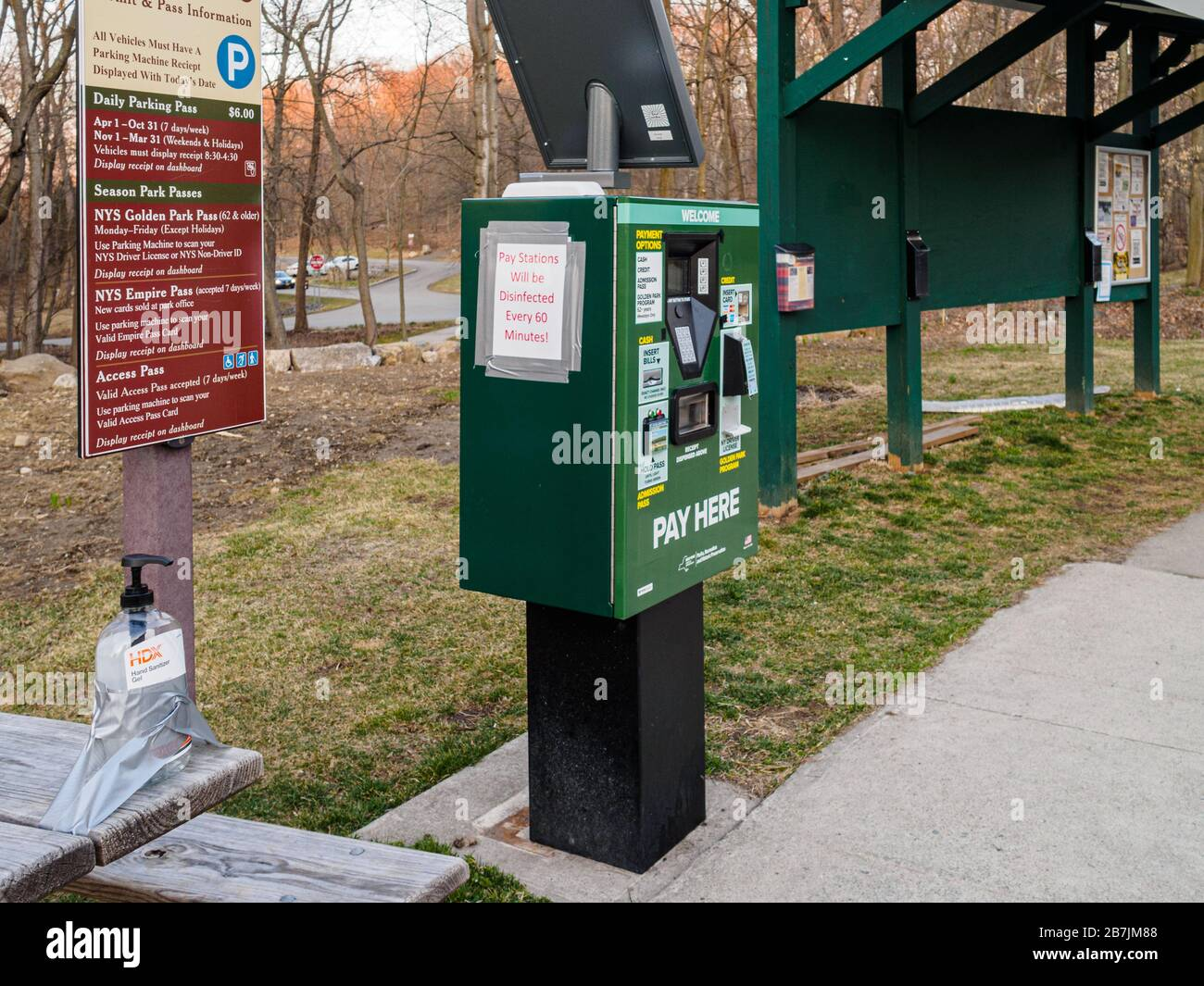 westchester-county-new-york-15-march-2020-a-bottle-of-hand-sanitizer-is-secured-by-duck-tape-in-the-parking-lot-of-rockefeller-state-park-preserve-for-hikers-sign-that-parking-meter-is-disinfected-hourly-over-coronavirus-fears-westchester-county-currently-has-the-highest-incidence-of-covid-19-in-the-state-due-to-shortages-there-have-been-reports-of-people-stealing-hand-sanitizer-from-offices-and-other-public-spaces-2B7JM88.jpg