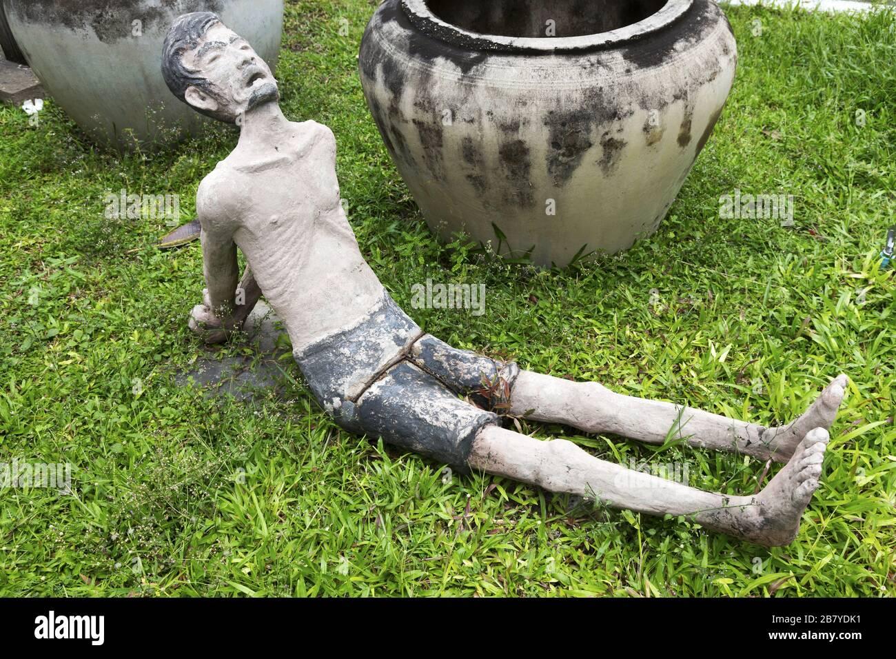 figure-of-tortured-prisoner-lying-on-gra