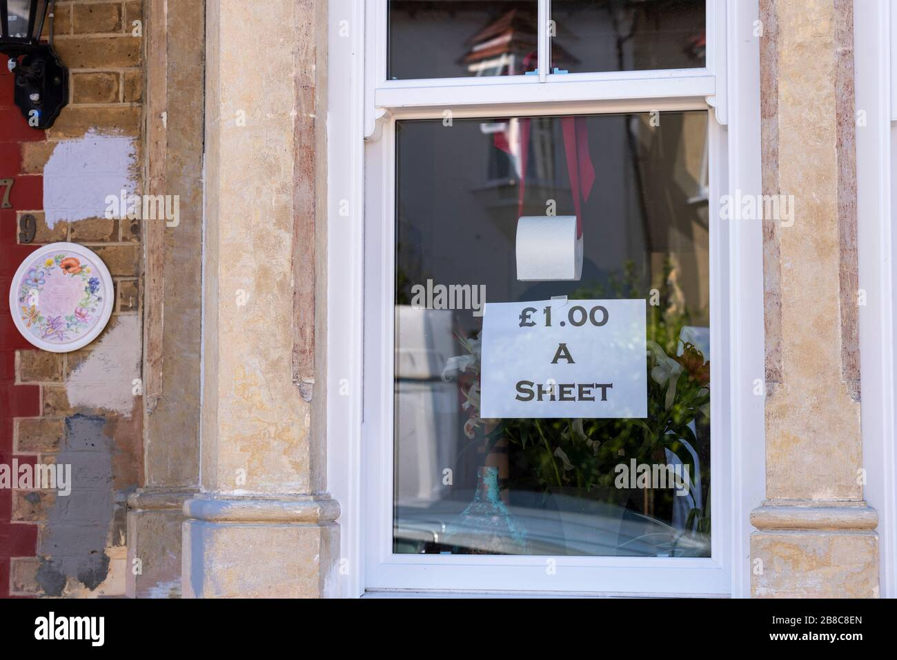 westcliff-on-sea-essex-uk-21st-march-2020-a-humorous-sign-in-a-window-in-macdonald-avenue-westcliff-is-offering-toilet-paper-at-1-per-sheet-other-signs-are-notifying-of-closures-and-a-shop-has-supplies-of-toilet-paper-and-hand-sanitizer-credit-avpicsalamy-live-news-2B8C8EN.jpg
