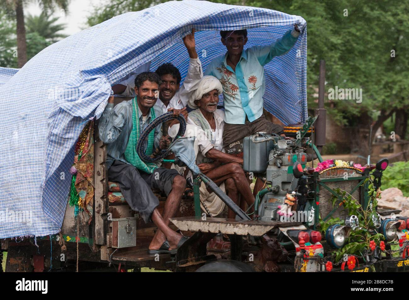 rickety-truck-carrying-a-group-of-people