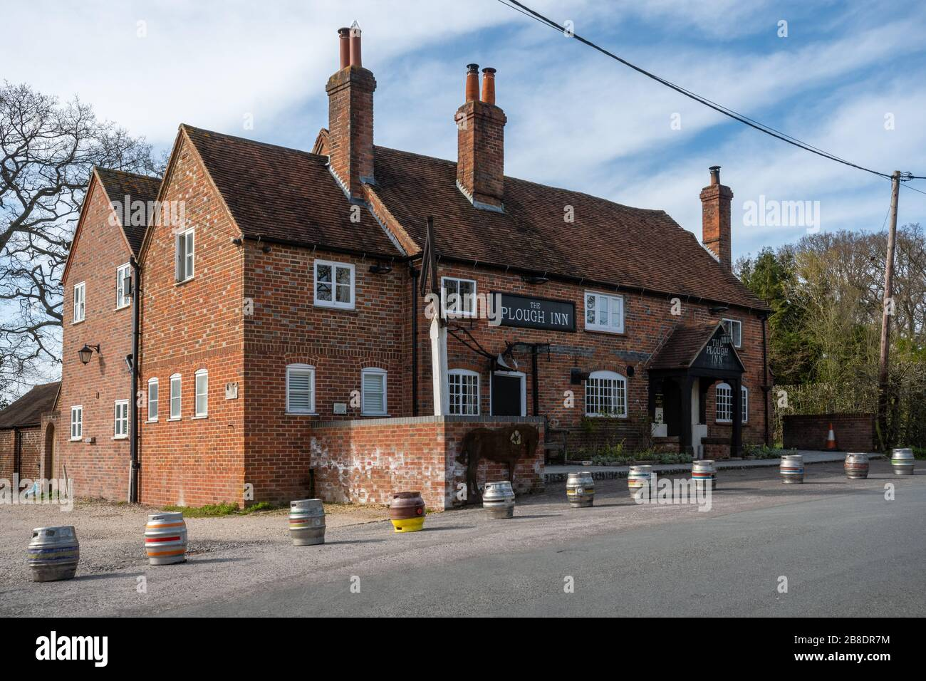 english-pub-closed-due-to-the-covid-19-coronavirus-pandemic-with-beer-kegs-lined-up-in-front-the-plough-inn-village-of-little-london-hampshire-uk-2B8DR7M.jpg
