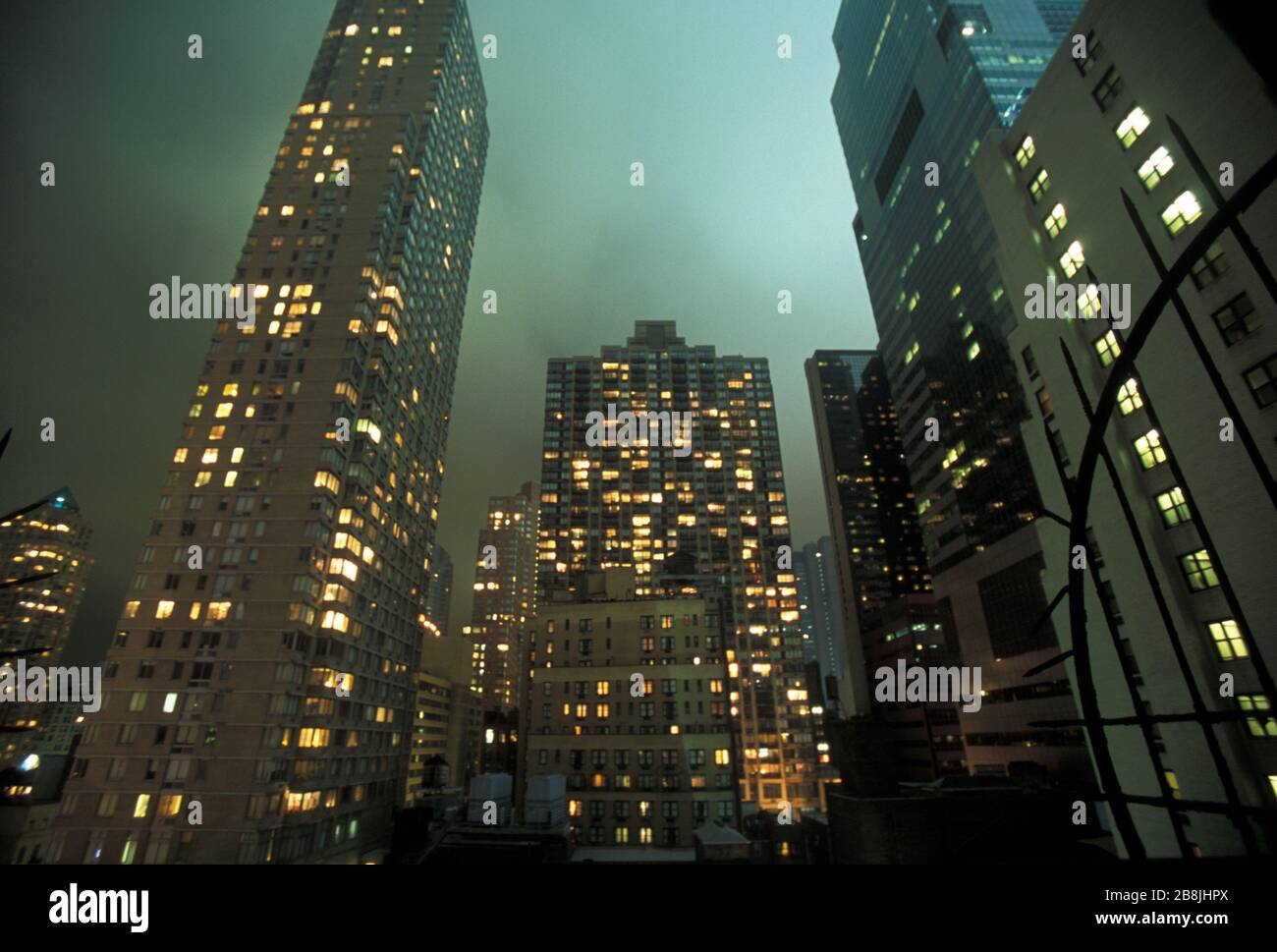 residential-building-in-manhattan-by-night-new-york-usa-2B8JHPX.jpg