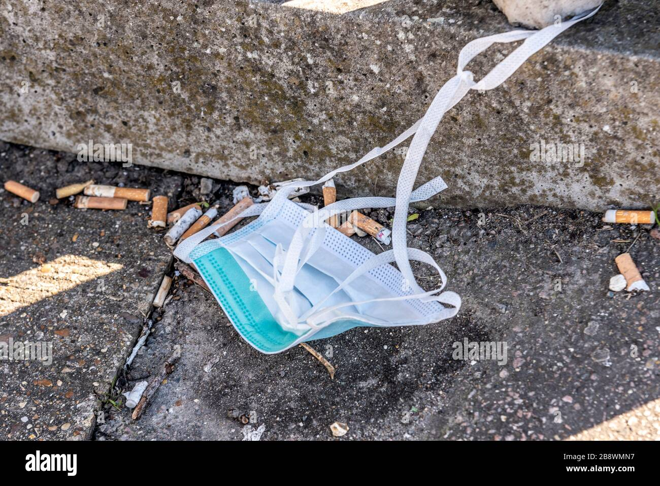 southend-on-sea-essex-uk-23rd-march-2020-the-roads-and-streets-are-much-quieter-after-the-weekend-some-people-are-out-shopping-a-mask-has-been-discarded-in-a-smoking-area-outside-southend-hospital-credit-avpicsalamy-live-news-2B8WMN7.jpg