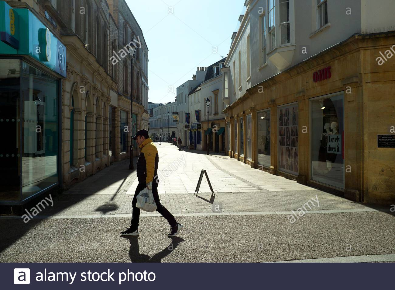 covid-19-coronavirus-pandemic-town-centre-scene-during-a-weekday-afternoon-in-cheltenham-gloucestershire-uk-23rd-march-2020-2B971P6.jpg