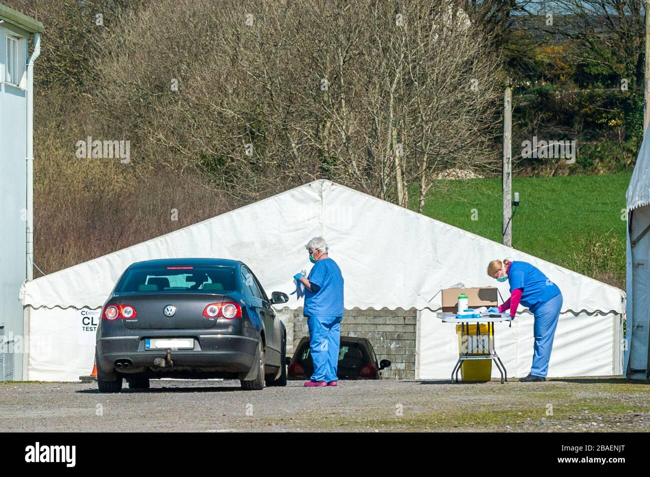 ballynacarriga-west-cork-ireland-27th-mar-2020-a-healthcare-worker-talks-to-the-driver-of-a-car-who-has-travelled-to-the-covid-19-swabtesting-centre-in-randal-og-gaa-club-for-the-occupants-to-be-tested-for-the-coronavirus-the-testing-station-was-originally-in-dunmanway-community-hospital-but-was-moved-yesterday-in-the-interests-of-the-health-of-elderly-patients-the-centre-is-the-only-such-facility-in-west-cork-credit-andy-gibsonalamy-live-news-2BAENJT.jpg
