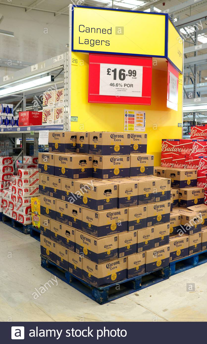 Boxes of canned Corona Extra lager beer for sale, in a store in Bristol, UK. Stock Photo