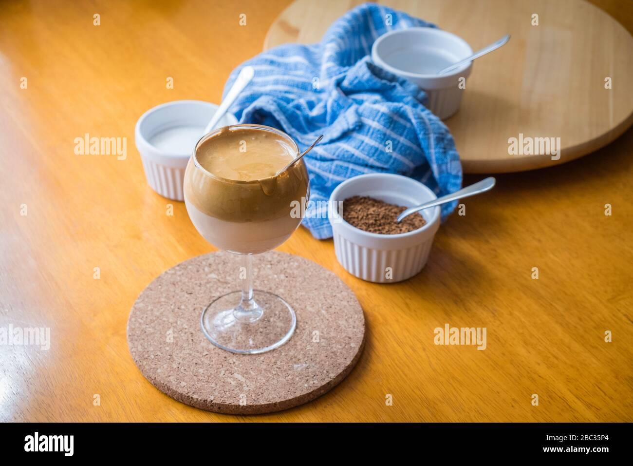 Dalgona Coffee, TikTok trending drink, with ingredients - coffee, sugar and water. Stock Photo