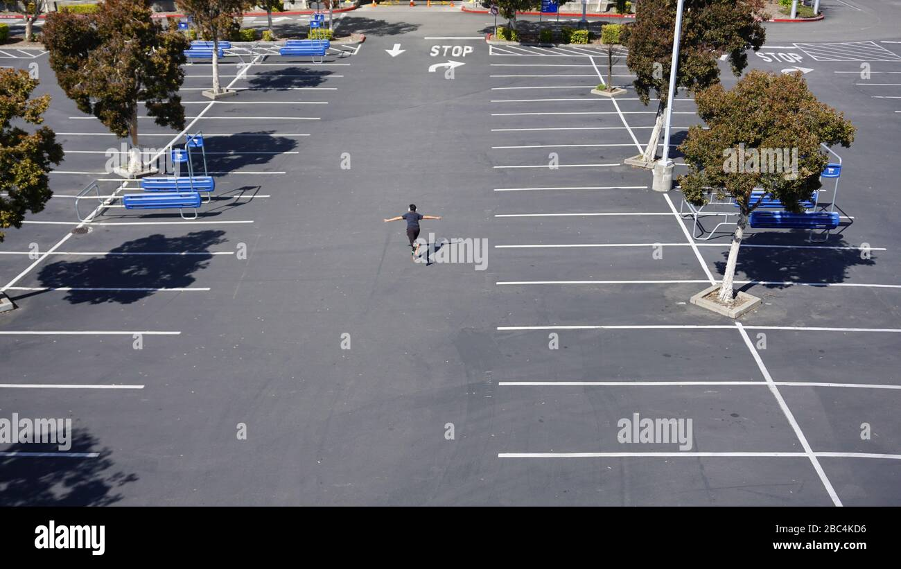 Rollerblader rollerblading in the IKEA parking lot, finding recreation during the COVID19, or coronavirus, lockdown shelter-in-place order. Emeryville Stock Photo