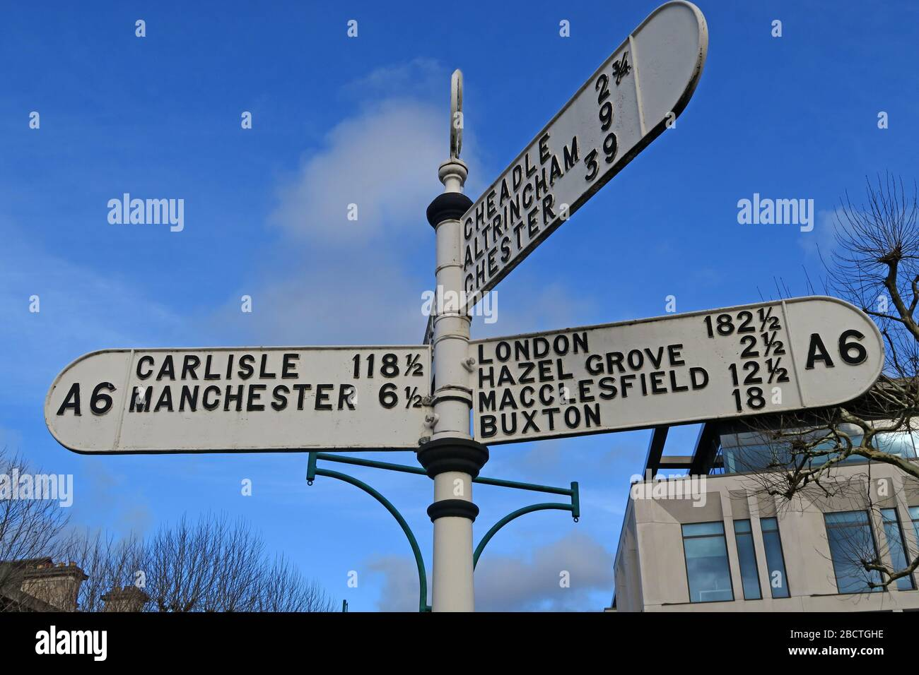 HotpixUK,@HotpixUk,GoTonySmith,Manchester,Cheshire,England,UK,town,white,sign,distances to,Carlisle,London,Hazel Grove,macclesfield,Buxton,Chester,Altrincham,Cheadle,Stockport.,Town Centre,Travel,Travellers,Traveling,tourist,tourism,destination,integrated,road network,north West,landmark,distance,SK1,Stockport Town Centre,guide post,heritage