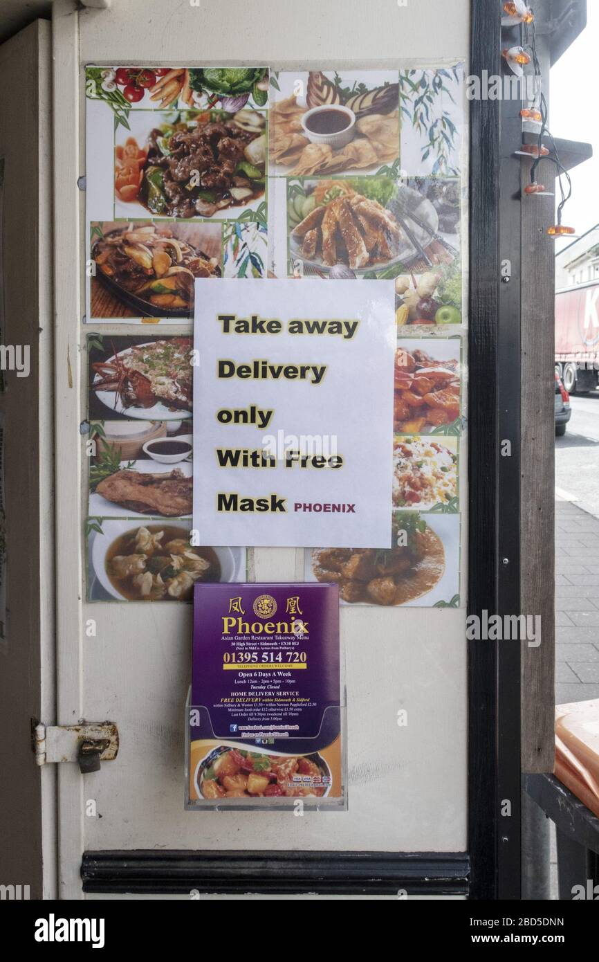Sidmouth, Devon, 7th Apr 2020 Notice outside a Chinese restaurant in Sidmouth, Devon, offering a free surgical mask with takeaway deliveries. Credit: Photo Central/Alamy Live News Stock Photo