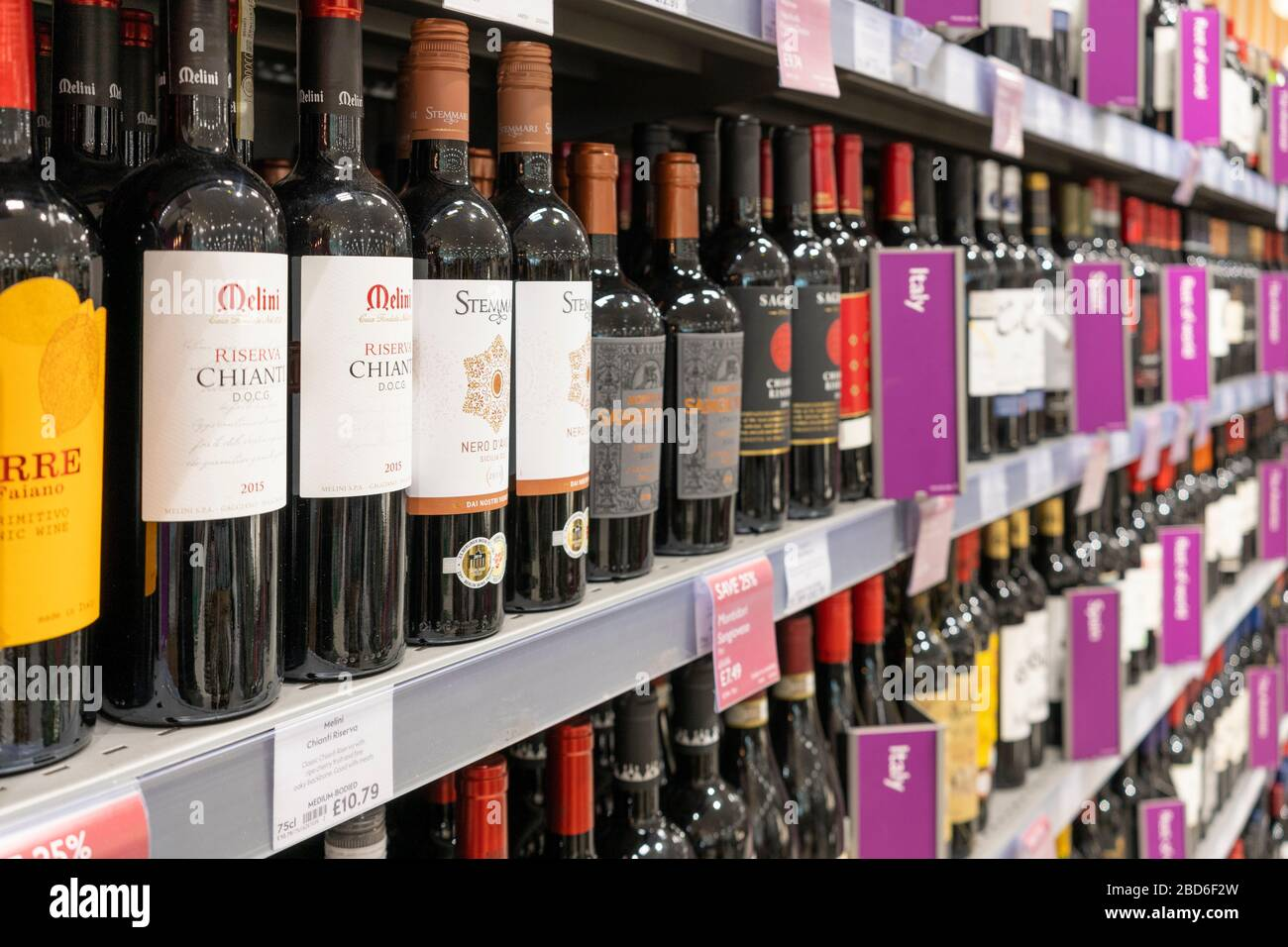 red-wine-bottles-on-display-on-shelves-f
