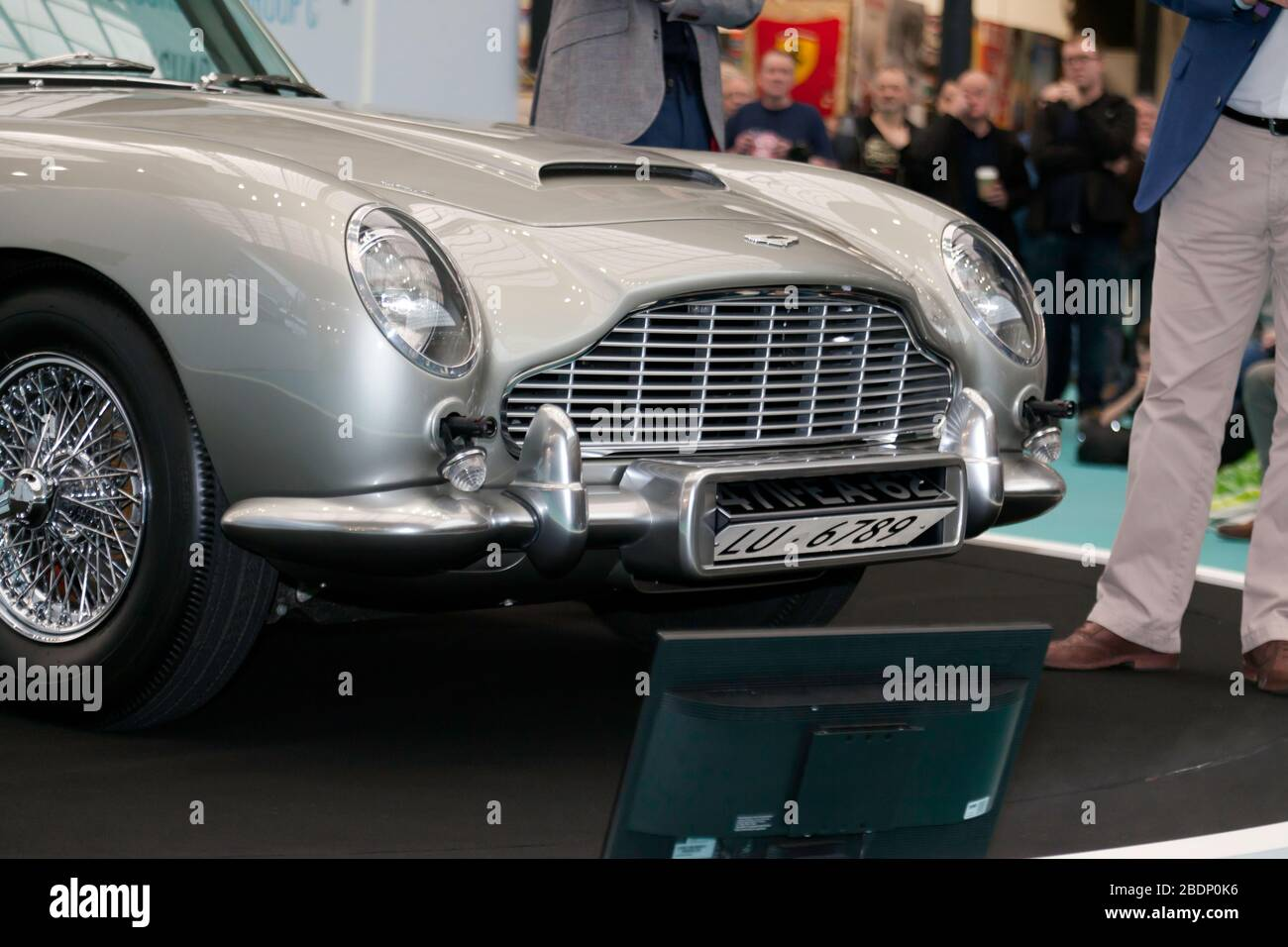 View of the front  of the Goldfinger Aston Martin DB5 Continuation  Car,  showing the front Machine Guns and Revolving Number Plate,  at the 2020 London Classic Car Show Stock Photo